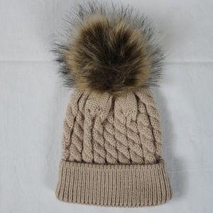 Tan knitted beanie hat pom pom